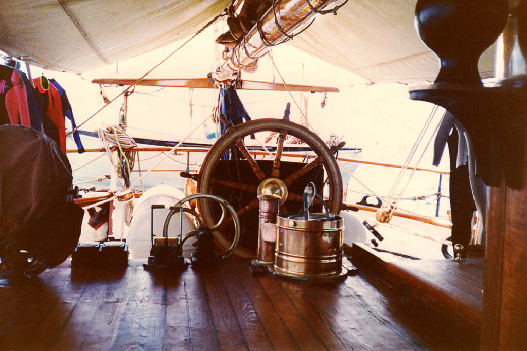 The ship's wheel at the helm of The Eye of the Wind.