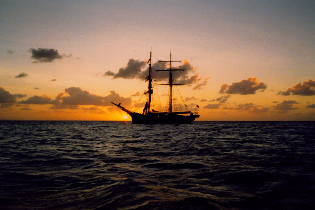The Eye of the Wind anchored at sunset in the Coral Sea.