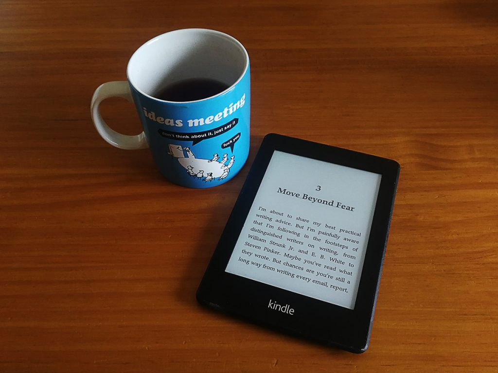 Tim Horans's kindle e-Reader beside a mug of tea.